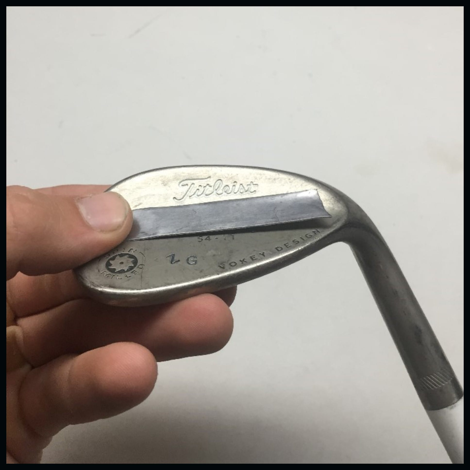 applying lead tape to iron or wedge